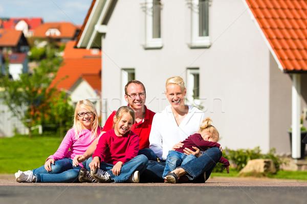 Boldog család ül otthon fiatal család nap Stock fotó © Kzenon
