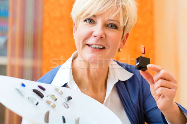 Deaf woman with hearing aid Stock photo © Kzenon