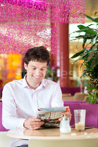 Young man in ice cream parlor Stock photo © Kzenon