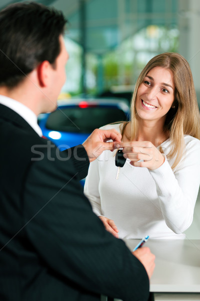 Stock photo: Woman buying car - key being given