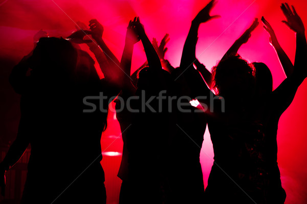 People dancing in club with lightshow Stock photo © Kzenon