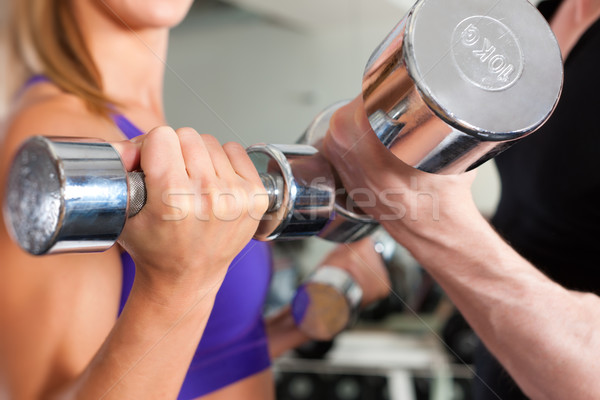 Sport - couple is exercising with barbell in gym Stock photo © Kzenon