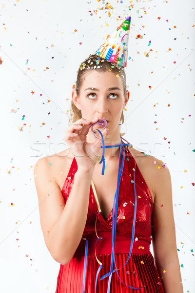 Woman at boring birthday party with streamer Stock photo © Kzenon