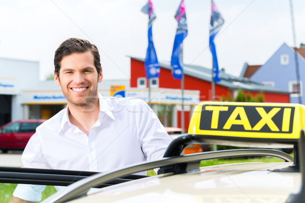 Driver in front of taxi waiting for clients Stock photo © Kzenon