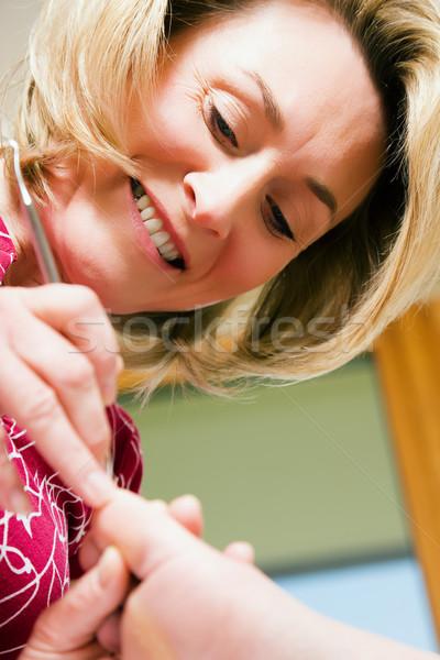 Lábápolás nő gyakorol elvesz törődés láb Stock fotó © Kzenon