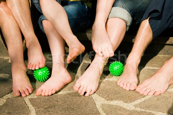 Healthy feet - feet gymnastics Stock photo © Kzenon