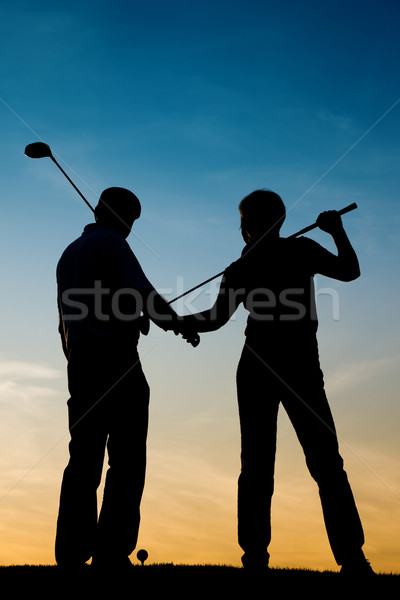 Senior couple playing Golf at sunset Stock photo © Kzenon
