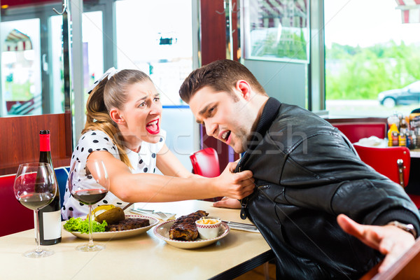 Couple eating and drinking in fast food diner Stock photo © Kzenon