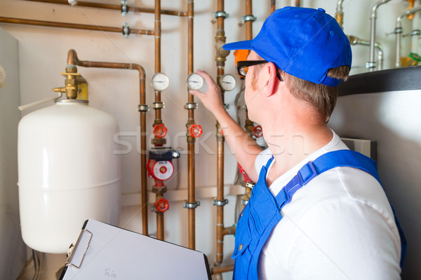 Engineer controlling the heating system Stock photo © Kzenon