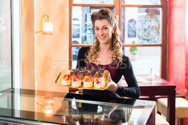Female baker in confectionery  Stock photo © Kzenon