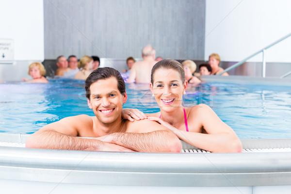 Pár fürdik úszómedence férfi egészség pihen Stock fotó © Kzenon