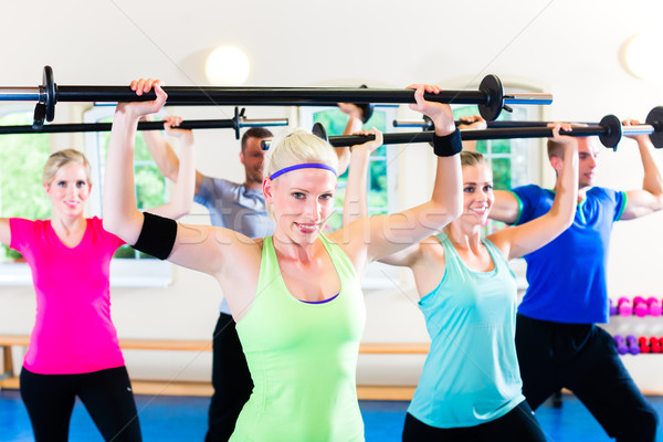 weight training in the gym with dumbbells Stock photo © Kzenon