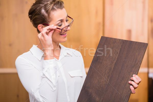 Interior architect choosing parquet wood floor Stock photo © Kzenon