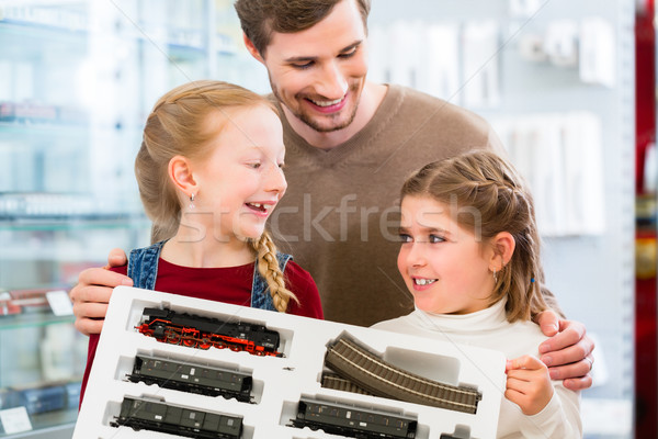 Stock photo: Family buying model railroad in toy store