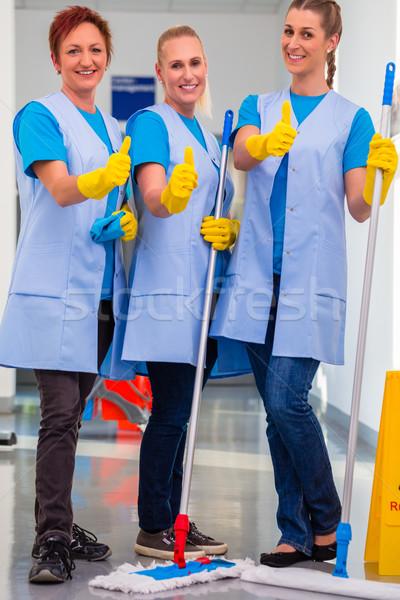 Cleaning ladies working in team Stock photo © Kzenon