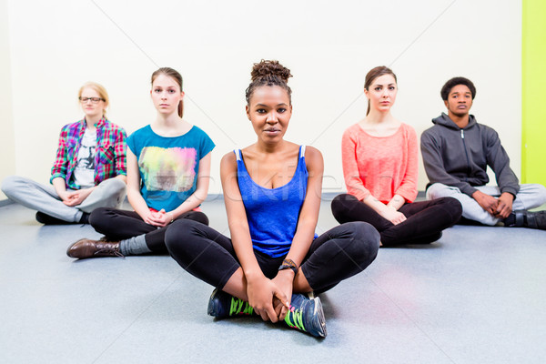 Group of friends mediating doing yoga Stock photo © Kzenon
