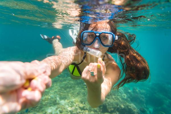 Femme tentant geste océan jaune bikini Photo stock © Kzenon