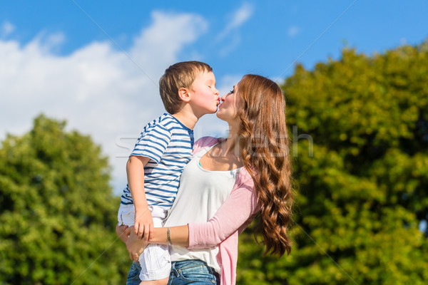 Mother holding son in arms kissing him  Stock photo © Kzenon