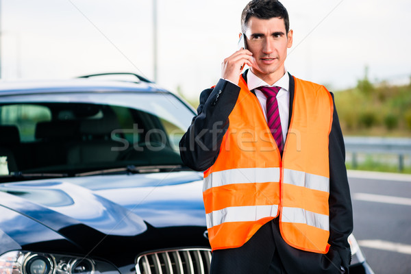 Man with car breakdown calling towing company Stock photo © Kzenon