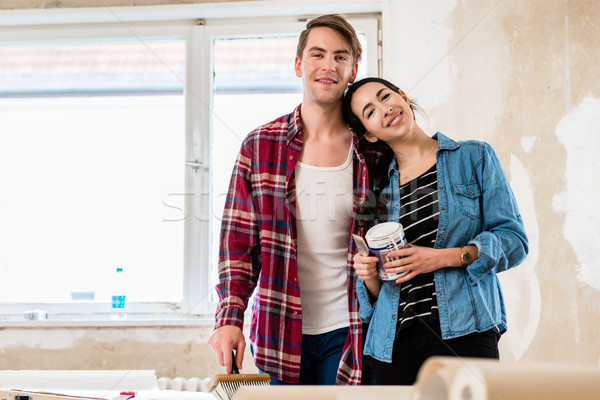 Portrait of a happy young couple holding tools for home remodeli Stock photo © Kzenon