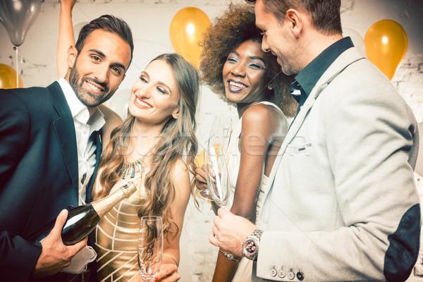 Grup kadın erkekler şampanya yeni Stok fotoğraf © Kzenon
