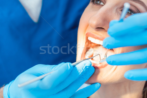 Close-up of the open mouth of a woman with white and healthy tee Stock photo © Kzenon
