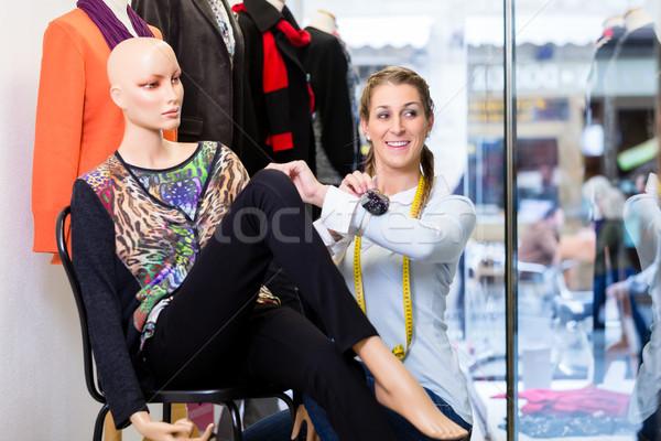 Window dresser working at shop promotion Stock photo © Kzenon