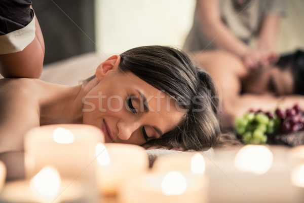 Beautiful young woman relaxing with her partner during Thai massage Stock photo © Kzenon