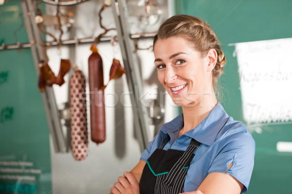 Smiling Female Butcher at Butchery Stock photo © Kzenon