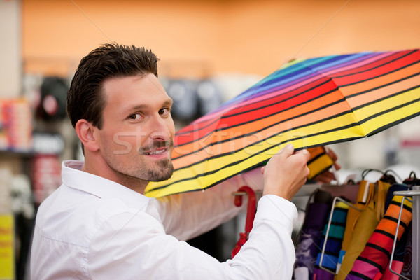 Stock photo: Handsome Man Shopping Umbrella at Supermarket