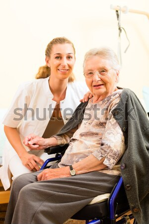 Young nurse and female senior in nursing home Stock photo © Kzenon