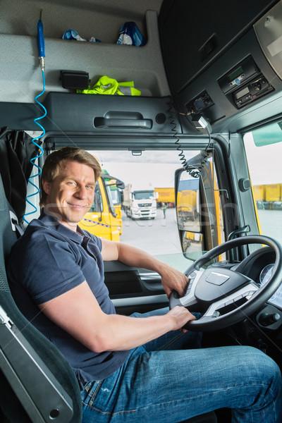 Forwarder or truck driver in drivers cap Stock photo © Kzenon