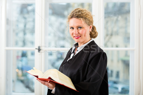 Lawyer in office with law book reading by window Stock photo © Kzenon