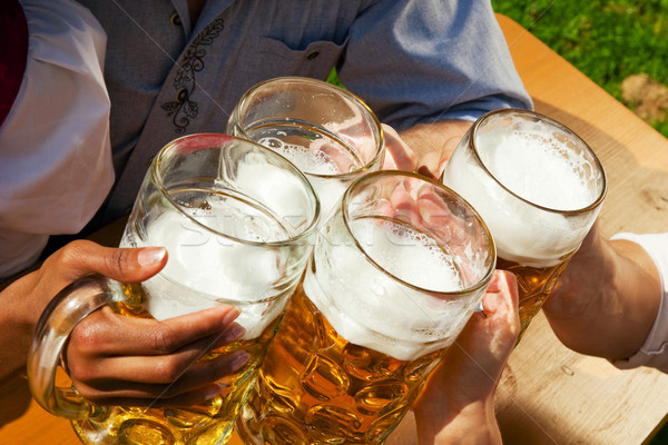 Group of four friends drinking beer Stock photo © Kzenon