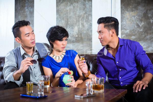 Asian man harassing woman in fancy nightclub Stock photo © Kzenon
