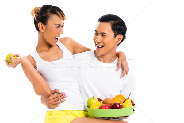 Asian couple eating fruit and living healthy Stock photo © Kzenon