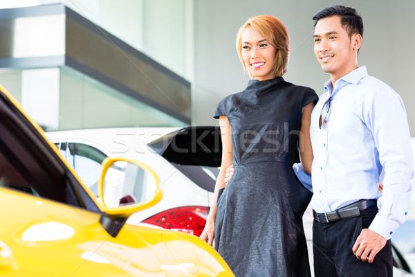 Asian couple choosing roadster car in dealership Stock photo © Kzenon