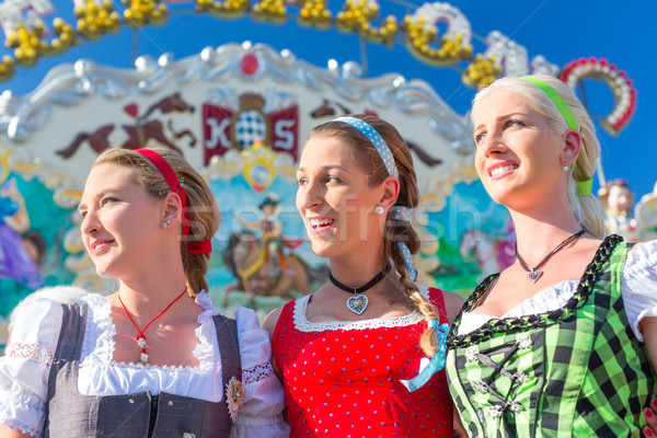 Friends visiting Bavarian fair having fun Stock photo © Kzenon