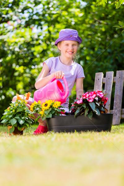 Gyermek locsol virágok kert boldog otthon Stock fotó © Kzenon