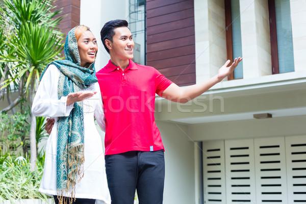Asian Muslim couple choosing house Stock photo © Kzenon