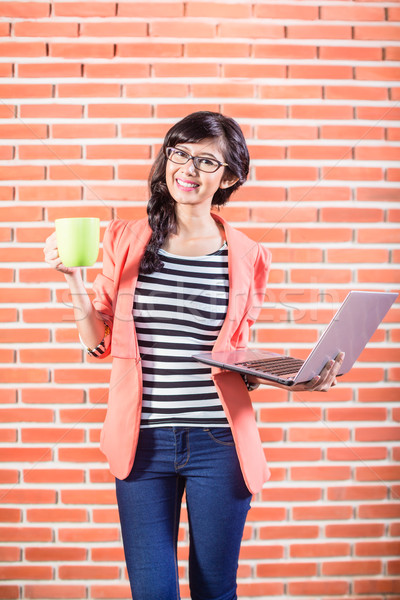 Asian college student with Laptop and coffee Stock photo © Kzenon