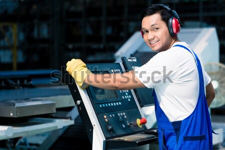 Team of workers with metal sheets at cutter Stock photo © Kzenon