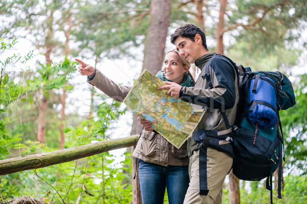 Man and Woman on hike looking for the right trail on map  Stock photo © Kzenon