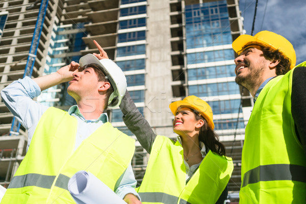 Team of architects inspecting construction site Stock photo © Kzenon