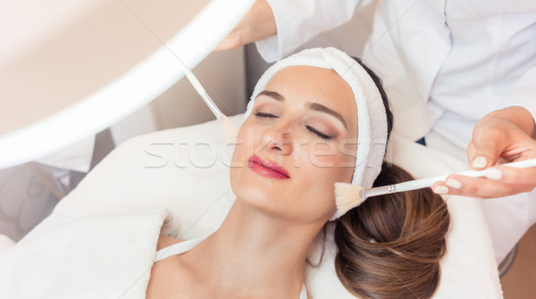 Beautiful woman during anti-aging facial massage in a modern cos Stock photo © Kzenon