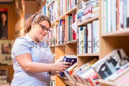 Woman in bookstore looking for book Stock photo © Kzenon