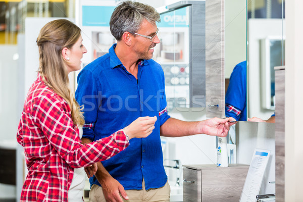 Shop assistant in hardware store counseling customer about lavat Stock photo © Kzenon