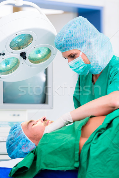 Orthopedische chirurg patiënt arts chirurgie ziekenhuis Stockfoto © Kzenon