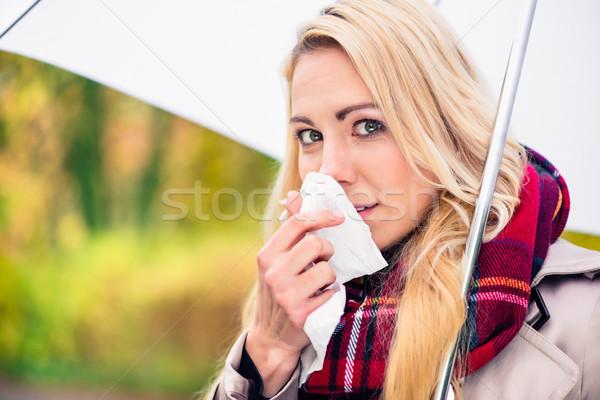 Woman having cold or flu due to bad autumn weather Stock photo © Kzenon