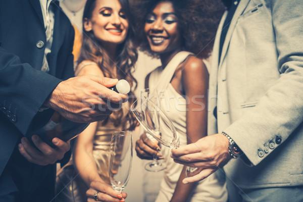 Férfi nyitás pezsgő üveg ünneplés klub Stock fotó © Kzenon